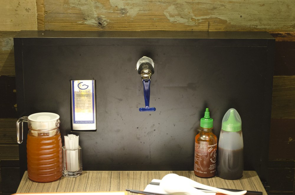 Fuhn restaurant's water tap. humidwithachanceoffishballs.com